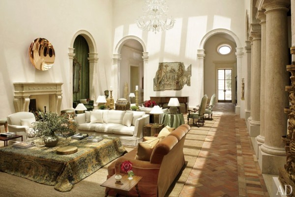 The living room walls of a Las Vegas villa designed by Atelier AM are finished with integral plaster, imbedded with a Roman mosaic panel from the second century. An overscale cocktail table is draped in an antique French tapestry. The chandelier is Murano glass. Photo by Pieter Estersohn for AD.