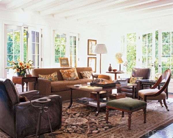Designer Kerry Joyce created a clubby British setting for Ben Soleimani, an avid polo player, in the family room of his 1920's house in Beverly Hills. Elle Decor; photo by Roger Davies.