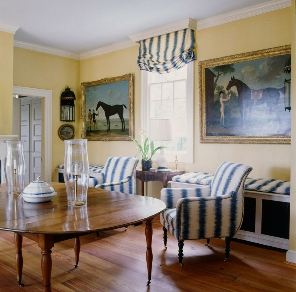 Paintings of horses hang in the kitchen dining room decorated by Suzanne Rheinstein. House Beautiful.