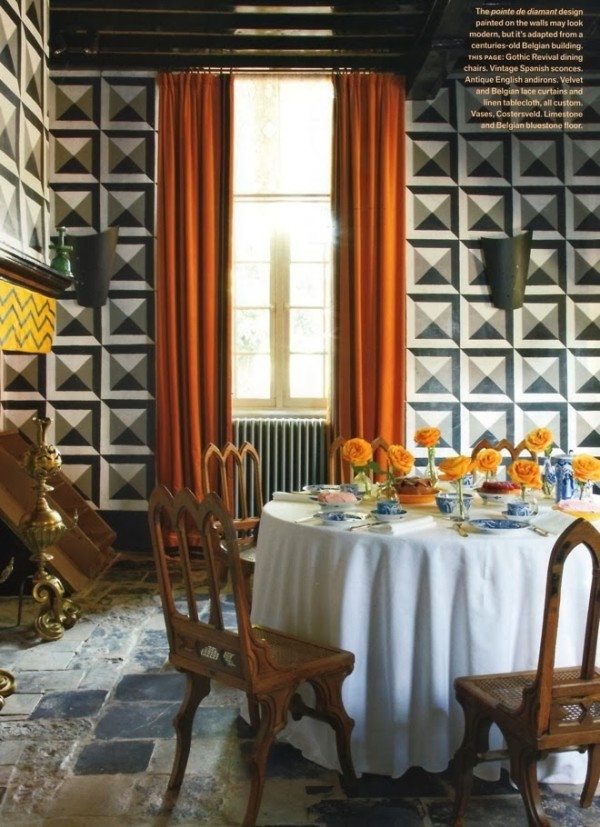 The dining room in antique dealer Jean-Phillipe Demeyer's Belgian home. Veranda; photo by Miguel Flores-Vianna.