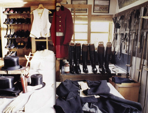 A vast collection of top hats, waistcoats, riding  boots, gloves, and sporting regalia in the valeting room at Robin Smith-Rylands Sherbourne country house. Racks of whips and spurs share wall space with hunting prints. March 1989. Photo by Oberto Gili.