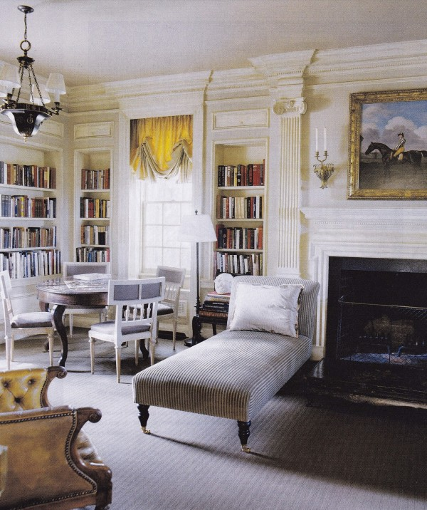 A library designed by Suzanne Rheinstein in Virginia features an equestrian painting over the fireplace. House Beautiful.