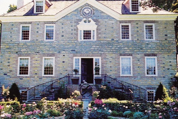 A c. 1757 country house in New England constructed of local stone by Italian craftsman. House & Garden; photo by Karen Radkai.