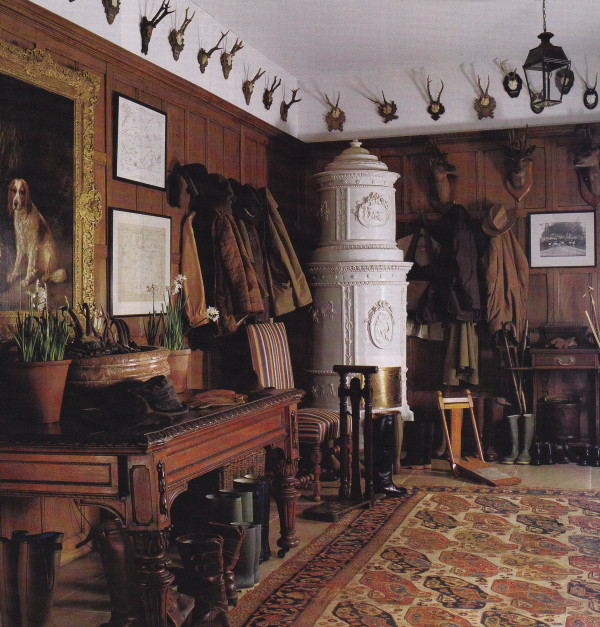 The oak-paneled boot room in a country manor house in southern England decorated by Robert Kime. Photo by Fritz von der Schulenburg.