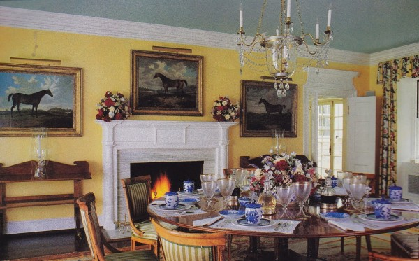 On the fireplace wall in the dining room decorated by Vincent Fourcade hang portraits of hunters by the 19th-century British painter A. S. Boult. House & Garden; photo by Karen Radkai.