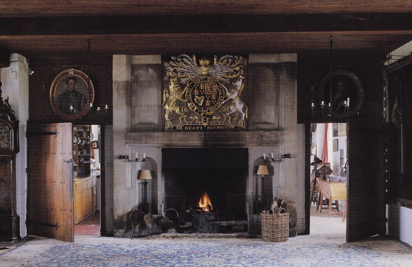 """The coat of arms above the fireplace in the Big Hall at Hilles contains the motto """"Blessed are the Peacemakers"""". It is a replica of the original at Dorfold Hall in Cheshire. The World of Interiors; photo by Tim Beddow."""