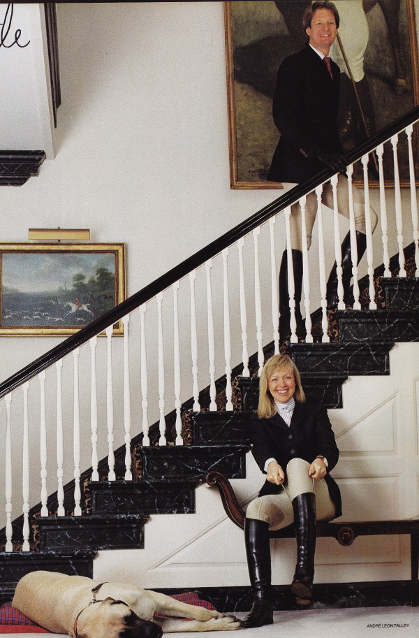 C.Z.'s son, Alexander, and his wife Liza, posing in their riding suits in the entrance hall at Templeton. The small sporting painting is by James Seymour. HG; October 1988. Photo by Michael Mundy.