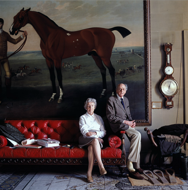 """The Duke and Duchess of Devonshire sitting beneath """"Flying Childers"""" painted by James Seymours in the West Hall at Chatsworth. Photo by Simon Upton."""