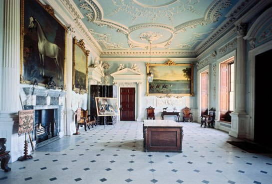 The Great Hall at Badminton House, the Duke of Beaufort's home in Gloucestershire, England, as photographed by Derry Moore.