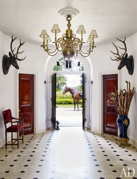 The entry hall in the Lauren's Bedford home evokes the ambiance of a fabled equestrian estate. Photo by Björn Wallander.