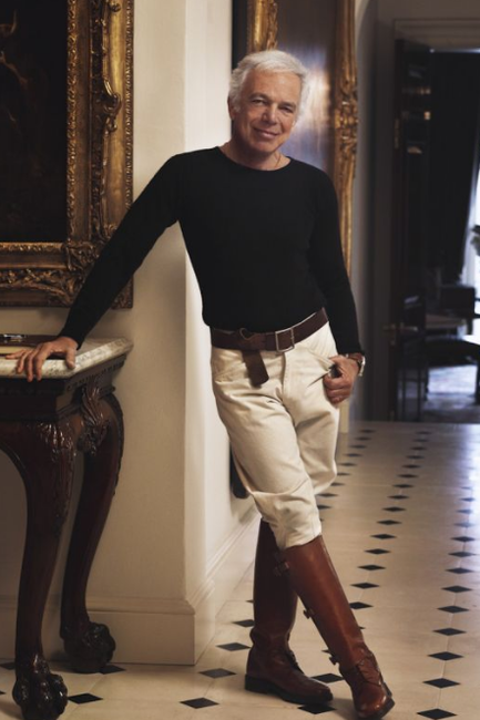 Ralph Lauren posing in the entry hall of his Bedford home dressed for riding.
