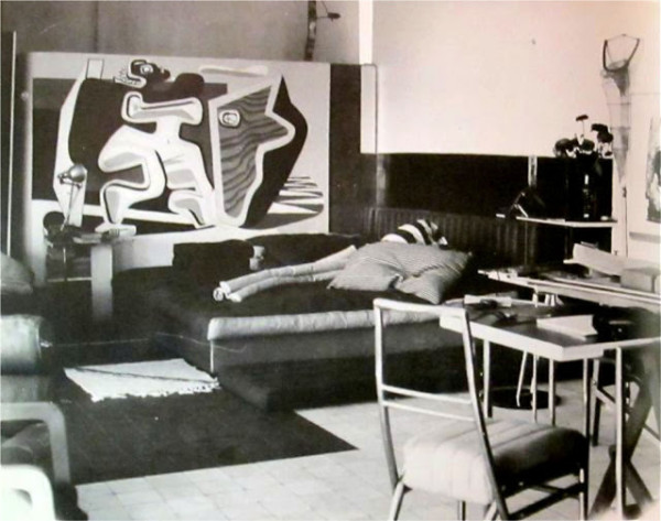 A vintage view of the salon with the addition of a mural by Le Corbusier. Photo from L'Architecture Vivante, c. 1930.