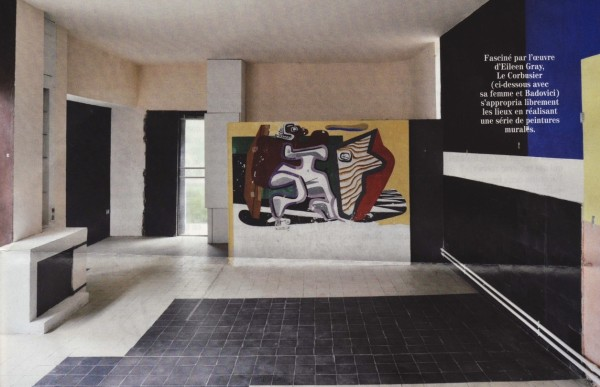 A view of the main salon as it appeared prior to restoration, with Le Corbusier's mural on the back wall. Photo by Luc Castel.