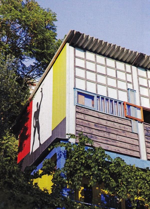 Le Corbusier's five cabins - Unités de Camping - with a mural of a man waving, above Gray's villa E.1027. Photo by Simon Watson.