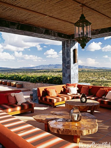 The upstairs loggia of John Houshmand's Mexican hacienda, furnished with  mesquite banquettes and tables made from mesquite slabs, offers spectacular views. Photo by William Abranowicz.