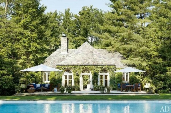 Ralph Lauren's Bedford, New York, poolhouse is surrounded by towering pines. Photo by  Björn Wallander.