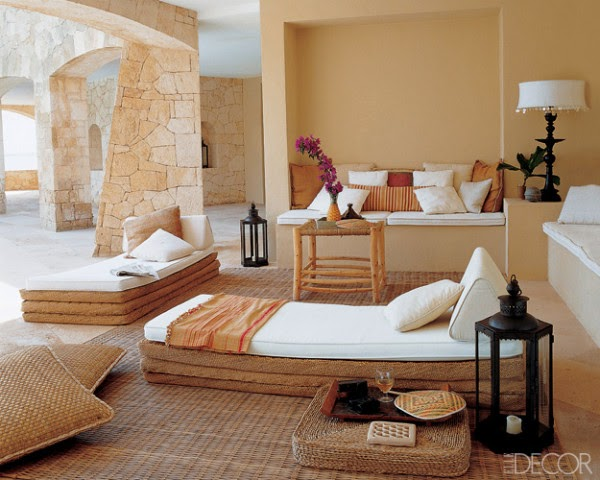 Straw and canvas mattresses and rattan cushions are arranged for sheer comfort and relaxation on the shaded arcade of Antonio and Ignacio Saorin's vacation villa on the island of Ibiza. Photo by Simon Upton.