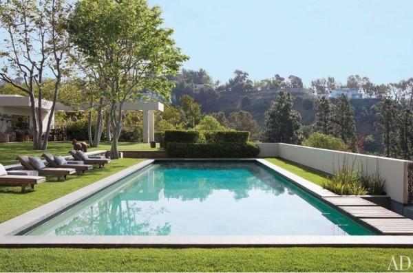 Brazilian-granite coping borders the pool at Ellen DeGeneres and Portia de Rossi's Beverly Hills, California, estate. Photo by Roger Davies.
