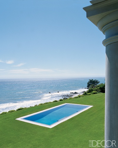 An elegantly simple lap pool overlooking the Pacific set into the lawn of a Palladian-style villa designed by Michael S. Smith in Malibu. Photo by Simon Upton.