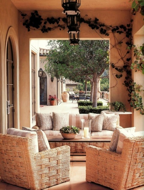 Michael Smith furnished a Tuscan-style loggia in Montecito designed by architect Don Nulty with woven rope outdoor furniture. Photo by Lisa Romerein.