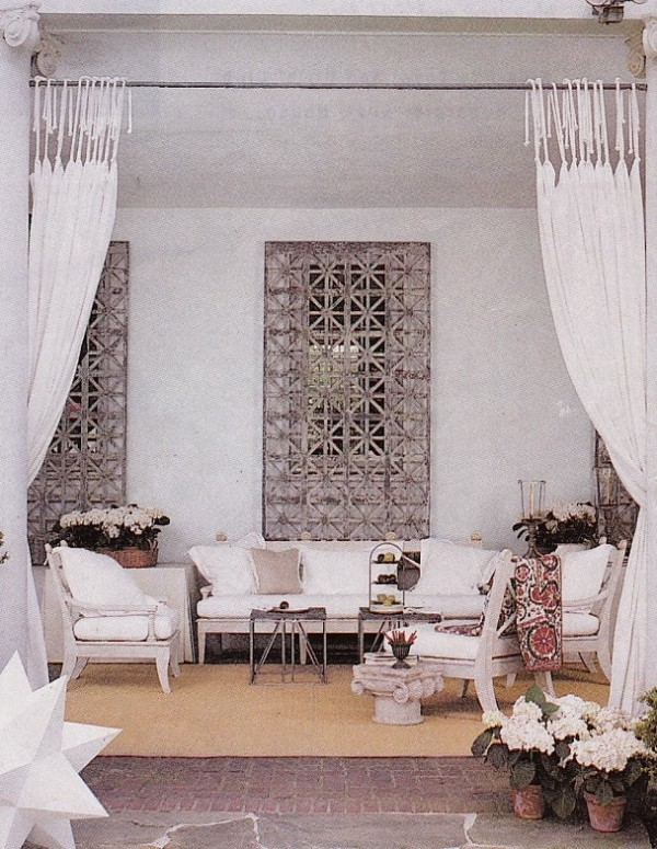 """The late Antony Childs created a classical mood in all-white for a Alexandria Decorator Showhouse. """"This is my bow to the Italian loggia. I wanted it to be romantically evocative, and as comfortable as being indoors. The view is of lawn, boxwood and flowers. The bright white acts as a beautiful juxtaposition for the garden beyond"""" explained Childs. Photo by Gordon Reall for House Beautiful."""