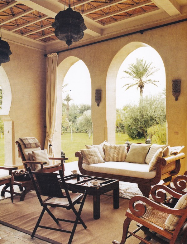LIz Landau decided upon a neutral palette over the traditional vibrant style more commonly used in Moroccan interiors for the loggia in her villa, Manzah al Jamil. Custom furniture made in Bali for the villa has a decidedly British Colonial air. Photo by Paul Costello for Town & Country.