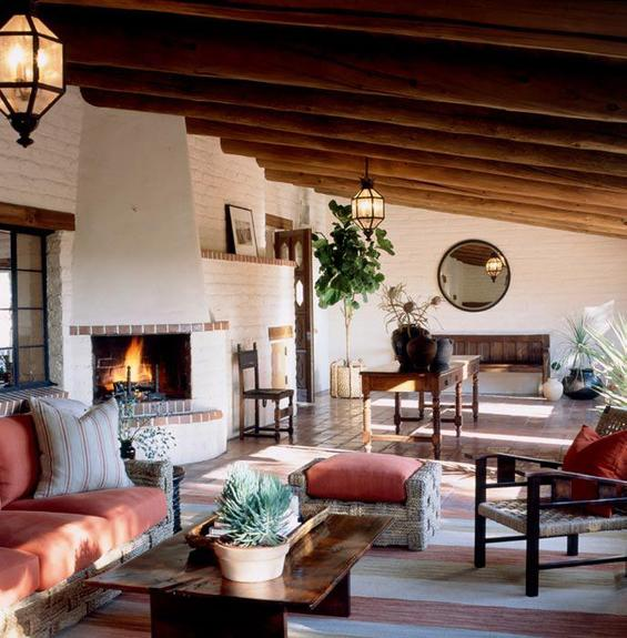 The expansive loggia of an a Spanish revival home designed by Scott Snyder it warm and gracious. Photo by Josh Klein.