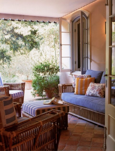 Michael S. Smith arranged a casual mix of vintage wicker covered in periwinkel on the veranda a Portuguese-style quinta in Montecio, California. Photo by Lisa Romerein.