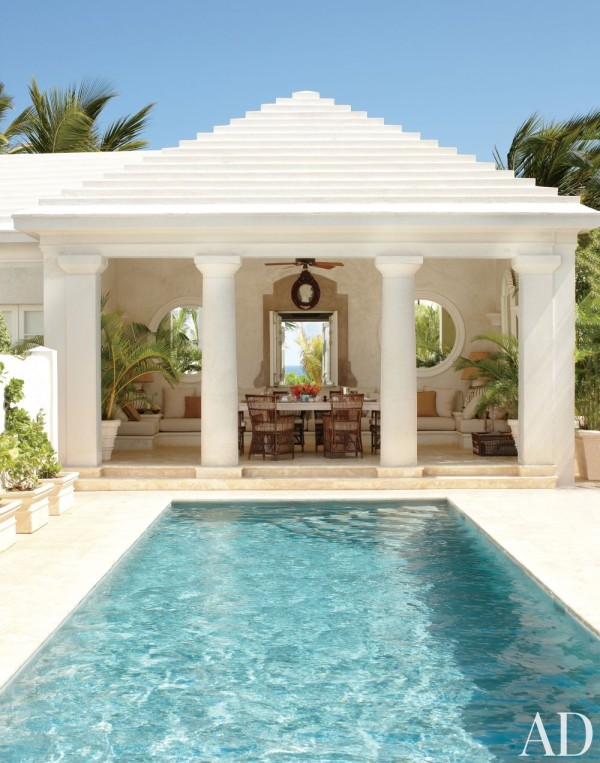 The poolhouse of an estate in the Dominican Republic decorated by Genevieve Faure references classical design with Doric columns and a stepped roof. Photo by Oberto Gili.