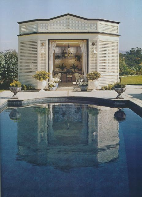 Jack Lowrance conceived a pair of lattice pavilions for al fresco entertaining on the property of a Woodside, California, home in the 1970's. Photo by Max Eckert. From Architectural Digest: California Interiors, 1979.