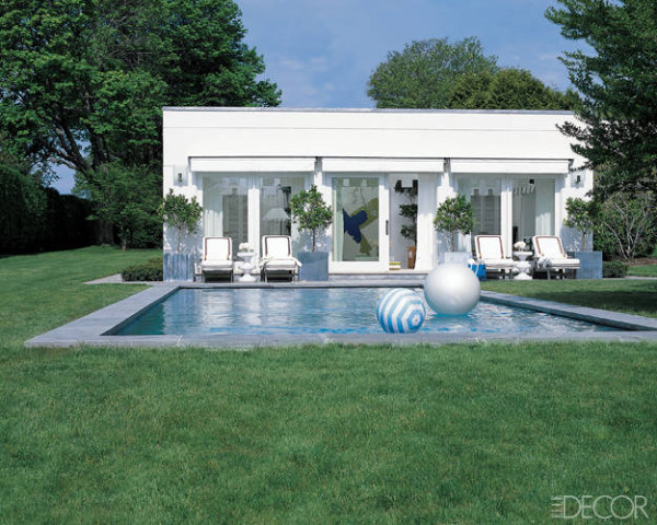 At the beach retreat of Coach president and creative director Reed Krakoff and his wife, Delphine, in Southampton, New York, the modernist pool and poolhouse reflect the clean-lined 1970s style of the main house. Photo by Reed Krakoff.