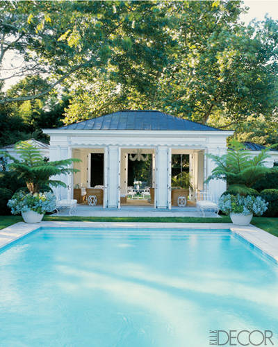 The crisp and classic poolhouse at Aerin Lauder Zinterhofer's East Hampton, New York, home. Photo by William Waldron.