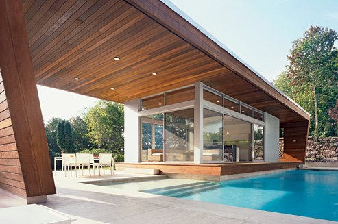 A contemporary, ipe-paneled poolhouse in Wilton, Connecticut, designed by Gisue Hariri. Photo by Paul Warchol.