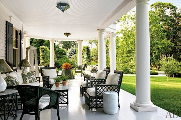 Miles Redd updated the veranda of an all-American Connecticut home with a suite of freshly painted antique wicker furniture floating on an expanse of immaculate painted floors. Photo by Miguel Flores-Vianna.