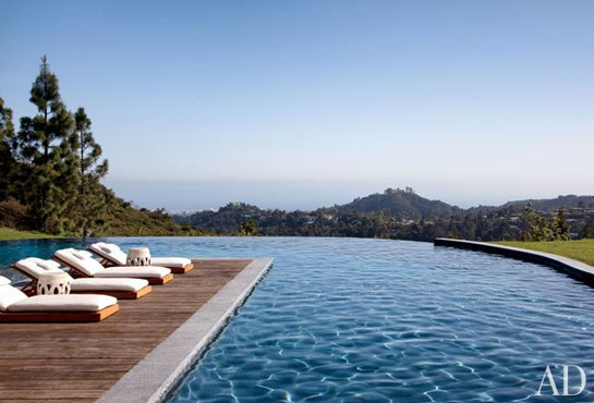 Gisele Bündchen and Tom Brady's pool terrace offers views out over Los Angeles, with the Pacific Ocean in the distance. Photo by Roger Davies for Architectural Digest.
