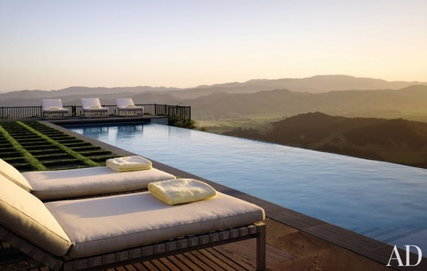 At a home in Napa, an infinity pool at the garden's north end overlooks the valley. Inset stone pavers turn the lawn into an artful grid, a design by Blasen Landscape Architecture. Photo by Matthew Millman.