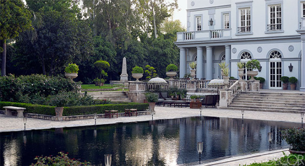 A large dark bottom pool in the style of a reflecting pond for a neoclassical-style villa in New Dehli with interiors by Jean-Louis Deniot. Photo by Richard Powers.