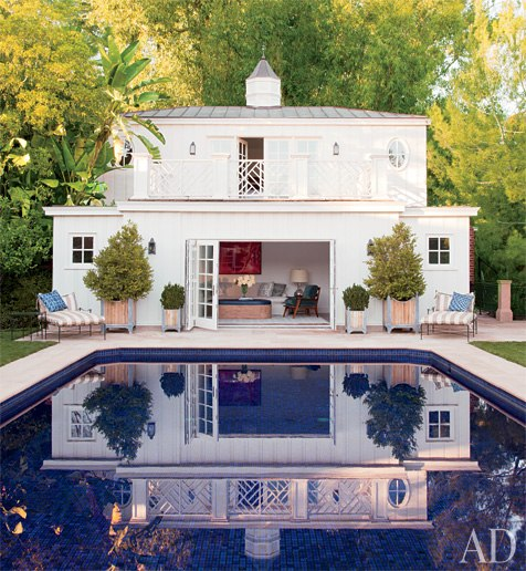 A neo-Regency poolhouse  designed by Appleton & Associates also functions as the guest quarters. Photo by Roger Davies.