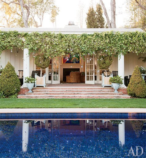 A loggia off a screening room overlooks the swimming pool of a house in Beverly Hills. Photo by Roger Davies.