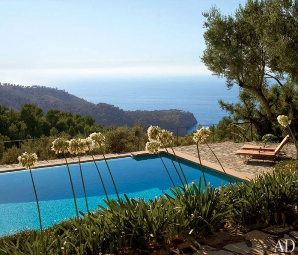 For an estate in Mallorca the pool was sited at the edge of a bluff to take in the views beyond. Photo by Tim Beddow for Architectural Digest.