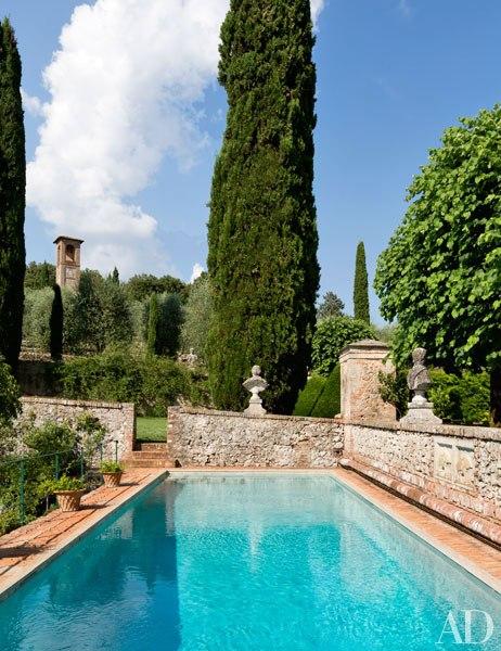 Ancient stone walls surround the swimming pool at Villa Cetinale, Tuscany. Photo by Oberto Gili.