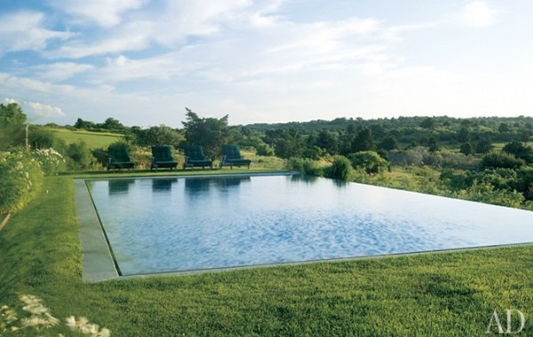 Captivated by Nantucket's peacefulness, a California couple traded Beverly Hills for the Massachusetts island. Across the broad lawn from their main house is an infinity pool that stretches out amid wild roses, lilacs, and indigenous grasses and looks out over 300 acres of wilderness. Photo by David O. Marlow.