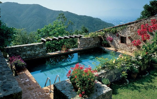 Architect Robert Brannen's  pool is nestled below the main stone farmhouse in Tuscany , which runs some adjacent to some ruins.