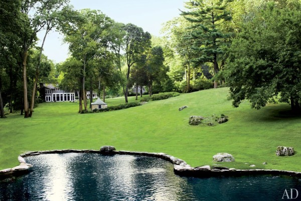 The stone-edged pool at decorator Elissa Cullman's Connecticut residence, Cedar Lodge Farm, resembles a natural pond set into the rolling lawn. Photo by Eric Piasecki.