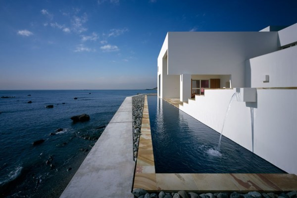 A pool in Japan is positioned between a starkly minimalist home and the sea. Photo by : Katsuhisa Kida. From Kelly Klien's Pools: Reflections.