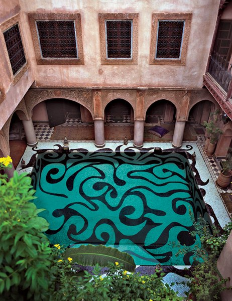 American artist Kris Ruhs created the exuberant tile pattern for this courtyard pool at the Marrakech residence of Franca Sozzani, the editor in chief of Vogue Italia. Photo by Ivan Terestchenko for Architectural Digest.