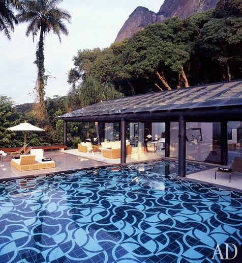 Designer Tino Zervudachi restored and furnished jet-setting investor Nat Rothschild's house in Rio de Janeiro. On a terrace facing the sea, Zervudachi laid out what became the urbane centerpiece of the residence: a pool whose elaborate Op Art tile design echoes the wave pattern on the famous Rio promenades by Roberto Burle Marx. Photo by Michael Calderwood.