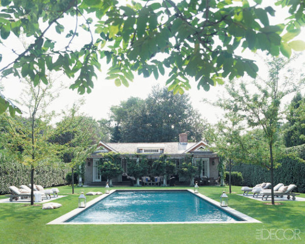 Landscape designer Deborah Nevins brings serene symmetry to the Bridgehampton, New York, property of advertising mogul Trey Laird and his family; towering boxwood hedges ensure privacy, while the terrace is shaded by a bamboo pergola. Photo by Pieter Estersohn.