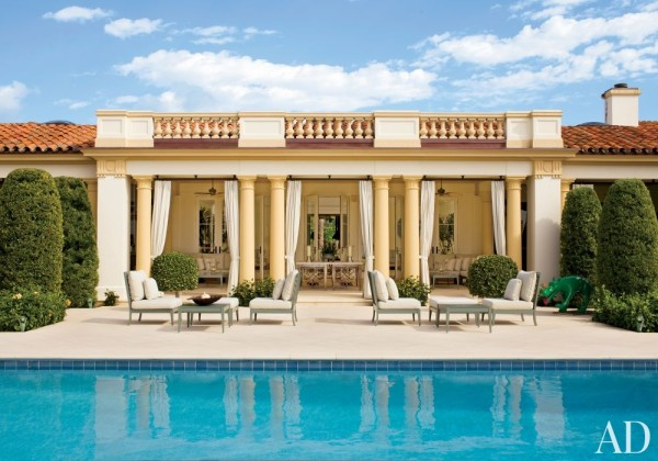 The poolside loggia of a Palm Beach residence decorated by Aman & Carson melds Beaux Arts and Mediterranean Revival traditions. Photo by Roger Davies.