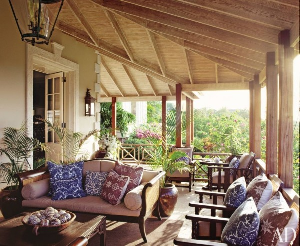 Grant White created an outdoor room for living with British Colonial elan on the upper veranda of home in Mustique. Photo by Tim Beddow for Architectural Digest.